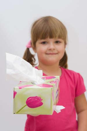 catarrh: cute, smiling girl inviting to take a handkerchief