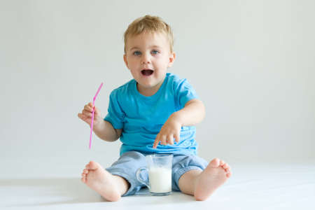 cheeky cute boy with glass of milk