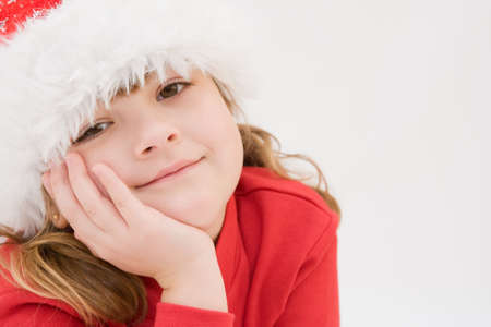 day dreaming: cute, little Santa girl, dreaming of Christmas Stock Photo