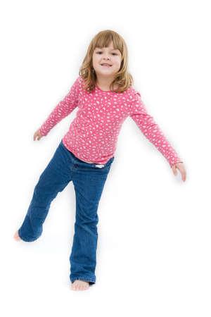 kid feet: cute, little girl enjoying freedom, on white