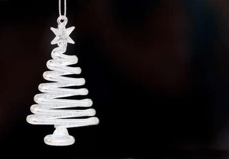 silver Xmas tree decoration on black background photo