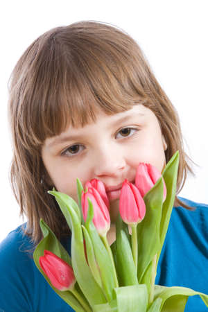 girl with bunch of spring tulips on white photo