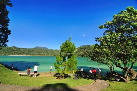 crater lake: People enjoying Linow Lake, a changing color lake in Tomohon, North Sulawesi, Indonesia