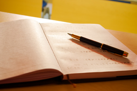 notebook and pen Editorial
