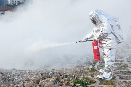 Someone in a fireproof suit