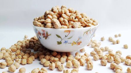 chic peas in bowl isolated on white background