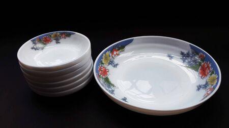 crockery bowls isolated on black background