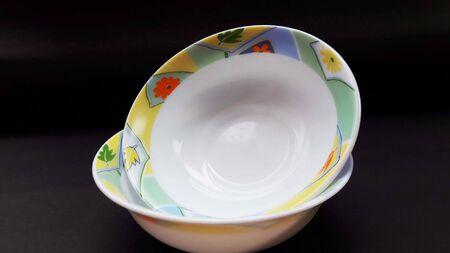 crockery bowl isolated on black background closeup image