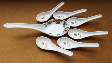 crockery spoon isolated on brown background close image