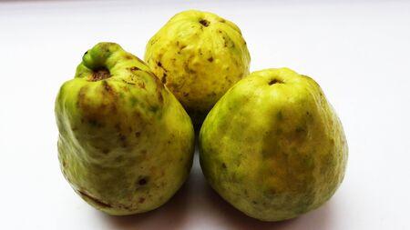 fresh guava isolated on white background closeup image