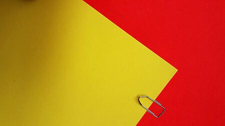 paper clip on color background with text space