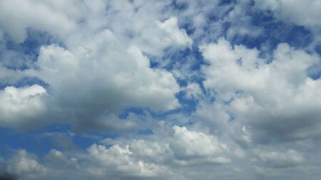 white fluffy clouds in blue sky in monsoon