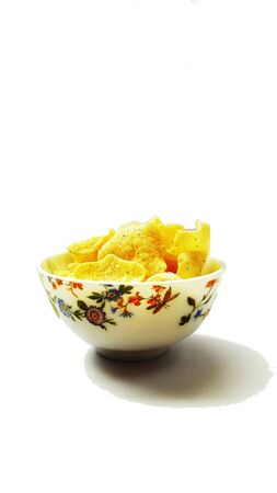 rice onion chips in bowl isolated on white background 写真素材