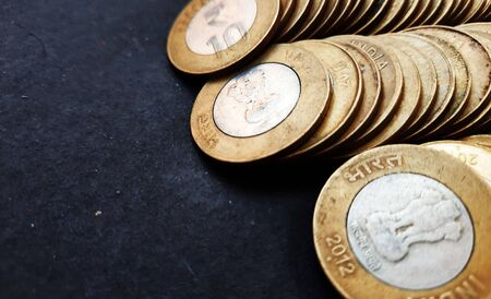 indian coins isolated on black background with text space 写真素材