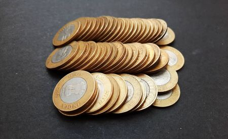 indian coins isolated on black background 写真素材