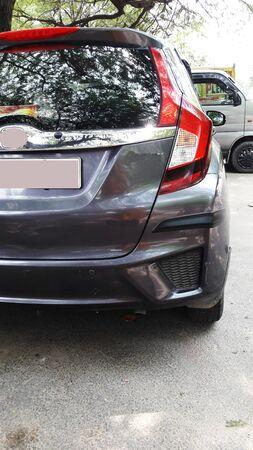 grey car backside view closeup image
