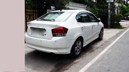white car parked at road side closeup image with text space