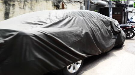 covered car parked at road side closeup image