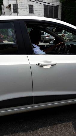 white car on road closeup image