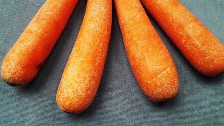 carrot isolated on grey background closeup image Stock fotó