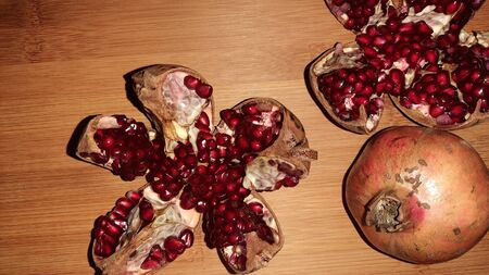 pomegranate and its seeds on wooden background Stok Fotoğraf