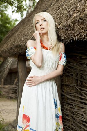 professionally: 21 Mpix full-frame HD-capture  Professionally retouched  Rural woman standing by old traditional Ukrainian house Stock Photo