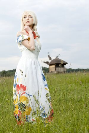 professionally: 21 Mpix full-frame HD-capture  Professionally retouched  Young rural woman standing at the green field