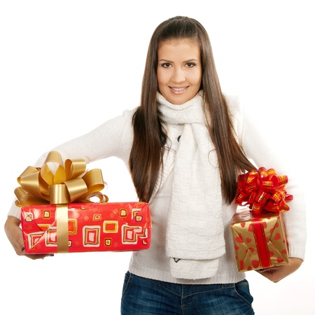 20 s: young brunette girl holding two gifts