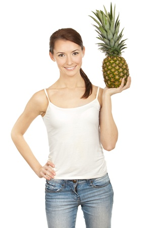 fullframe: Professionaly retouched HD full-frame capture  Beautiful brunette holding pineapple Stock Photo