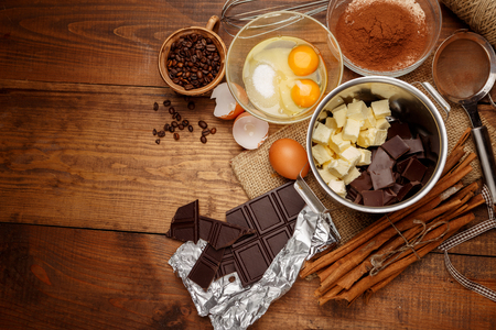 malted: Baking chocolate cake in rural or rustic kitchen. Dough recipe ingredients on vintage wooden table
