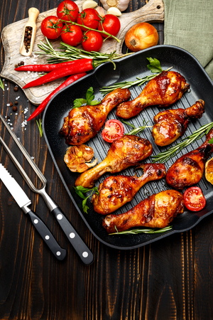 roasted chicken legs with herbs on wooden table Reklamní fotografie - 62136139
