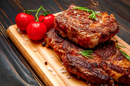 horseflesh: Roasted organic shin of beef meat on wooden table Stock Photo