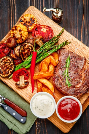 Roasted organic shin of beef meat on wooden table Stock Photo