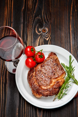 Roasted organic shin of beef meat on wooden background Stock Photo
