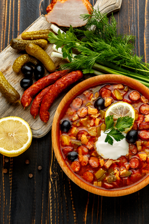 meat soup: Solyanka - Russian traditional meat soup on wooden background