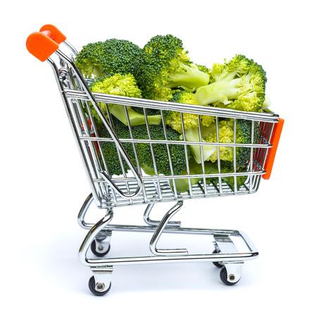 pushcart: mini shopping cart full with broccoli isolated on white background