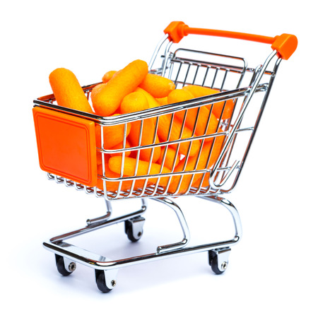 mini shopping cart full with carrots isolated on white background
