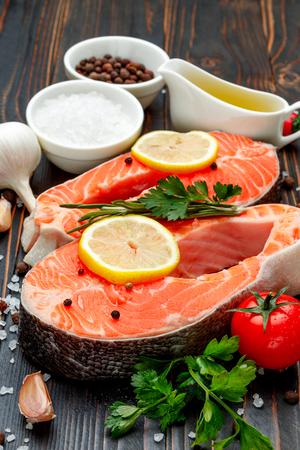Fresh Raw Salmon Red Fish Steak on wooden background