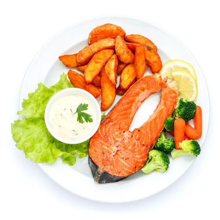 Studio shot of crispy roasted salmon steak Standard-Bild