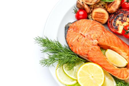 Studio shot of crispy roasted salmon steak Imagens