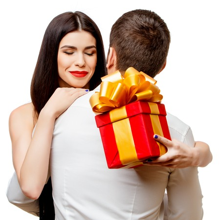 Young beautiful caucasian couple with present isolated on white