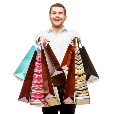 Full isolated studio picture from a young man with shopping bags