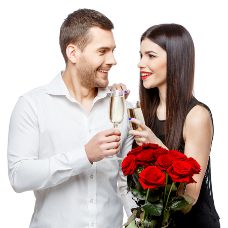 Young beautiful caucasian couple with flowers isolated on white