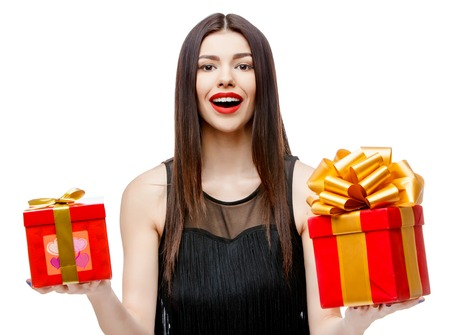 Attractive woman with gift box, isolated on white Stock Photo