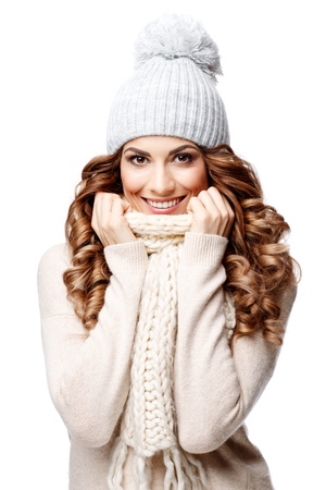 Beautiful young woman in knitted wool sweater smiling isolated on white Stock Photo
