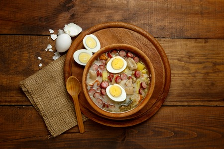 boiled sausage: Traditional Zurek with sausage and egg, white borscht, polish homemade Easter soup