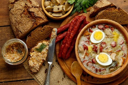 manjar: Traditional Zurek with sausage and egg, white borscht, polish homemade Easter soup