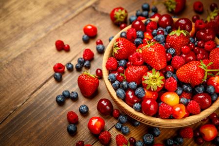 Studio shot of summer berries on wooden background