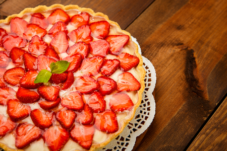 jello: Traditional homemade strawberry cake on wooden background