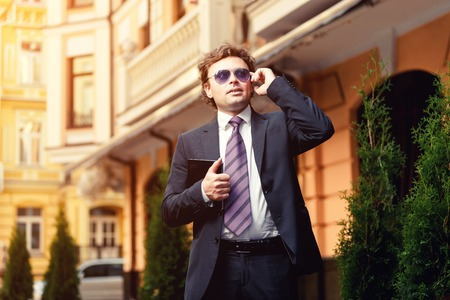Handsome mature caucasian businessman outdoor wearing suit Stock Photo
